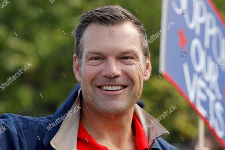 In this, photo, Kansas Republican gubernatorial candidate Kris Kobach waves at people during the Overland Park fall festival parade in Overland Park, Kan. Kobach faces Democratic state Sen. Laura Kelly and Independent candidate, businessmen Greg Orman in the Nov. 6 election