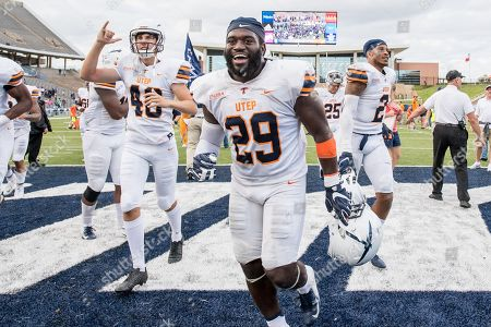 UTEP Miners linebacker Jamar Smith (29) and UTEP Miners place kicker Gavin Baechle (40) celebrate a victory after an NCAA football game between the UTEP Miners and the Rice Owls at Rice Stadium in Houston, TX. UTEP won the game 34 to 26