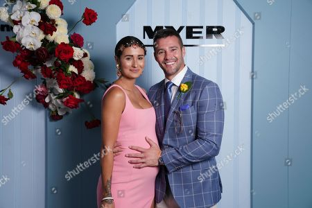 Myer Ambassador Kris Smith (R) wearing Dom Bagnato, poses for a portrait with his partner Sarah Boulazeris (L) during the Lexus Melbourne Cup Day, as part of the Melbourne Cup Carnival, at Flemington Racecourse in Melbourne, Australia, 06 November 2018.