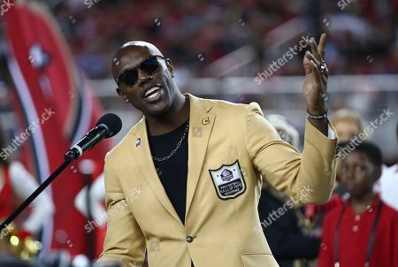 Former NFL wide receiver Terrell Owens speaks during a ceremony to receive his Pro Football Hall of Fame ring during halftime of an NFL football game between the San Francisco 49ers and the Oakland Raiders in Santa Clara, Calif