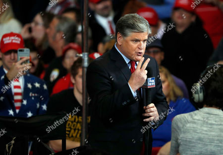 Television personality Sean Hannity does his show from the floor of a campaign rally, in Cape Girardeau, Mo