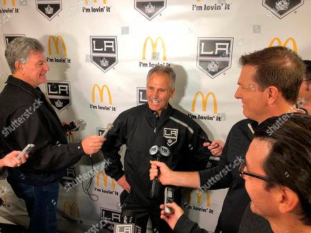 Los Angeles Kings interim coach Willie Desjardins reacts to a question from reporters after his first practice with his new team on . Desjardins is taking over for the fired John Stevens with hopes of improving the Kings' NHL-worst start to the season