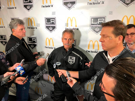 Stock Photo of Los Angeles Kings interim coach Willie Desjardins reacts to a question from reporters after his first practice with his new team on . Desjardins is taking over for the fired John Stevens with hopes of improving the Kings' NHL-worst start to the season