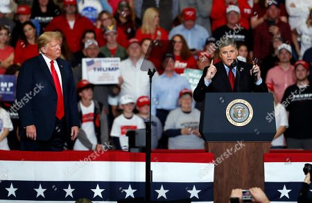 Television personality Sean Hannity, right, speaks as President Donald Trump listens during a campaign rally, in Cape Girardeau, Mo
