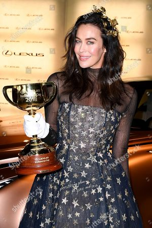 Model Megan Gale poses for a photograph with the Melbourne Cup in the Lexus marquee, during the Lexus Melbourne Cup Day, as part of the Melbourne Cup Carnival, at Flemington Racecourse in Melbourne, Australia, 06 November 2018.