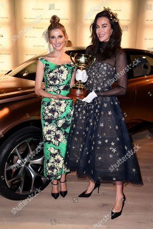Fashion writer Kate Waterhouse (L) and model Megan Gale (R) pose for a photograph with the Melbourne Cup in the Lexus marquee, during the Lexus Melbourne Cup Day, as part of the Melbourne Cup Carnival, at Flemington Racecourse in Melbourne, Australia, 06 November 2018.