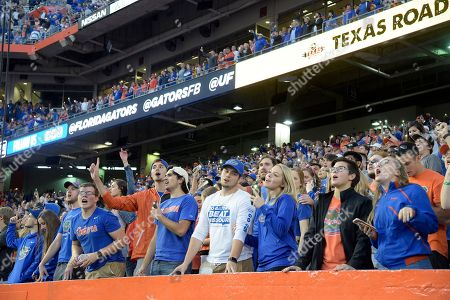 Florida fans sing along to a Tom Petty song in the stands during the second half of an NCAA college football game against Missouri, in Gainesville, Fla. Missouri won 38-17