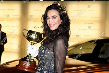 Australian model Megan Gale poses for a photograph with the Melbourne Cup in the Lexus marquee, during the Lexus Melbourne Cup Day, as part of the Melbourne Cup Carnival, at Flemington Racecourse in Melbourne, Victoria, Australia, 06 November 2018.