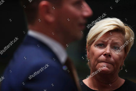Siv Jensen, Kristian Jensen. Norway Finance Minister Siv Jensen looks at Danish Finance Minister Kristian Jensen during an European Finance Ministers meeting at the European Council headquarters in Brussels