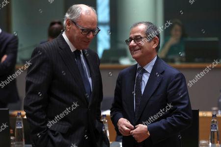 Giovanni Tria, Edward Scicluna. Italian Finance Minister Giovanni Tria, right, talks to Malta's Finance Minister Edward Scicluna during an European Finance Ministers meeting at the European Council headquarters in Brussels