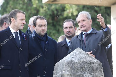 French president Emmanuel Macron (L) listens to Meuse Senator Gerard Longuet (R) next to French Junior Minister to the Minister of Territorial Cohesion and Relations with Territorial Communities, in charge of territorial communities Sebastien Lecornu (2-L) as they visit the Point X monument, a site of mines war, in Les Eparges, in Meuse region, Eastern France, 06 November 2018. Emmanuel Macron is on his second day of a week of commemorations for the 100th anniversary of the end of World War One, which is set to mix remembrance of the past and warnings about the present surge in nationalism around the globe.