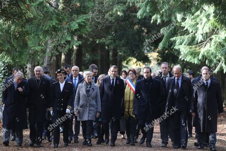 Stock Image of French president Emmanuel Macron (C) walks with the Mayor of Les Eparges Xavier Pierson (L), French writer Michel Bernard (2-L), the Prefect of the Meuse Muriel Nguyen (3-L), French Junior Minister for Defence Genevieve Darrieussecq (4-L), French Junior Minister to the Minister of Territorial Cohesion and Relations with Territorial Communities, in charge of territorial communities Sebastien Lecornu (3-R) and Meuse Senator Gerard Longuet from the Point X monument to Les Entonnoirs, a site of mines war, in Les Eparges, in Meuse region, Eastern France, 06 November 2018. Emmanuel Macron is on his second day of a week of commemorations for the 100th anniversary of the end of World War One, which is set to mix remembrance of the past and warnings about the present surge in nationalism around the globe.