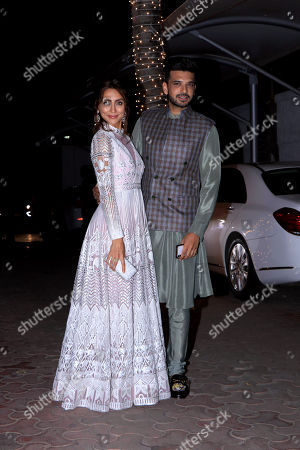 Stock Photo of Karan Kundra with Anusha Dandekar attend Shilpa Shetty's Diwali party at Juhu in Mumbai.