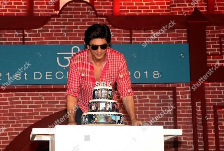 Indian actor Shahrukh Khan cutting the cake on his 53rd birthday at the trailer launch event of his upcoming film Zero in Mumbai.