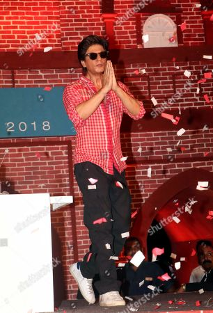Indian actor Shahrukh Khan pose on his 53rd birthday at the trailer launch event of his upcoming film Zero in Mumbai.