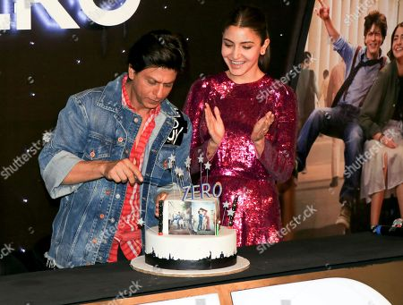 Indian actor Shahrukh Khan cutting the cake with Anushka Sharma on his 53rd birthday at the trailer launch event of his upcoming film Zero in Mumbai.