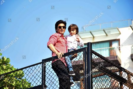 Indian actor Shahrukh Khan with son AbRam waves to fans on 53rd birthday at Mannat, Bandrra in Mumbai.