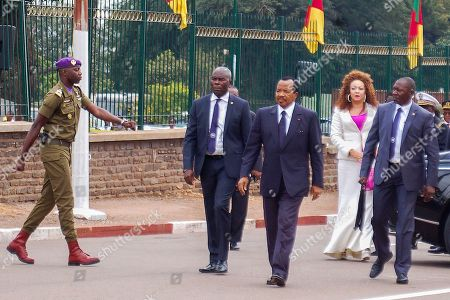 President Paul Biya (C) and wife Chantal (C-R) arrive for his swearing in ceremony at the National Assembly in Yaounde, Cameroon, 06 November 2018. Aged 86, Paul Biya was sworn in after 36 years in power for a consecutive seventh term in office after being declared winner of October 7 presidential election by the Constitutional Council.