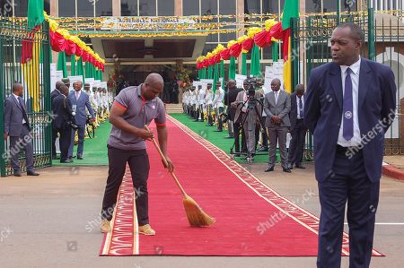 A worker sweeps the red carpet at the National Assembly for the swearing in ceremony of president Paul Biya in Yaounde, Cameroon, 06 November 2018. Aged 86, Paul Biya was sworn in after 36 years in power for a consecutive seventh term in office after being declared winner of October 7 presidential election by the Constitutional Council.