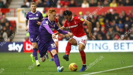 Joao Carvalho turns skillfully to stop the ball and get away from Stoke's James Woods