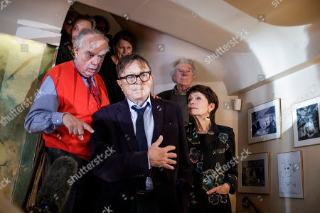 Stock Image of Medicis prize jury members Frederic Mitterand (L), Michel Braudeau (C) and others jury members announce the list of laureates of the 2018 prize for French novel and foreign novel to french writer Pierre Guyotat (unseen) and US writer Rachel Kushner (unseen) in Paris, France, 06 November 2018. The Prix Medicis are annual French literary awards.