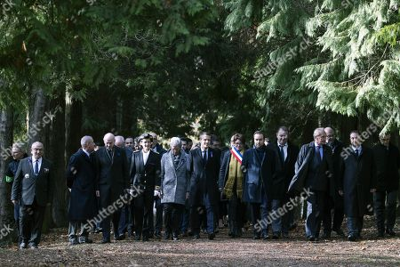 Stock Picture of French President Emmanuel Macron (C) walks with the Mayor of Les Eparges Xavier Pierson (L), French writer Michel Bernard (2-L), the Prefect of the Meuse Muriel Nguyen (3-L), French Junior Minister for Defence Genevieve Darrieussecq (4-L), French Junior Minister to the Minister of Territorial Cohesion and Relations with Territorial Communities, in charge of territorial communities Sebastien Lecornu (3-R) and Meuse Senator Gerard Longuet from the Point X monument to Les Entonnoirs in Les Eparges, eastern France, 06 November 2018, as part of ceremonies marking the centenary of the First World War. The French President kicked off a week of commemorations for the 100th anniversary of the end of World War One, which is set to mix remembrance of the past and warnings about the present surge in nationalism around the globe.