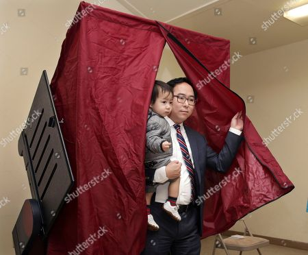 Andy Kim, the Democratic candidate in New Jersey's third Congressional District, holds his son, as he finishes voting, in Bordentown, N.J. Kim is facing Tom MacArthur, the Republican incumbent candidate in New Jersey's third Congressional District