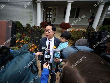 Andy Kim, the Democratic candidate in New Jersey's third Congressional District, holds his son Austin Kim, as addresses the media after voting, in Bordentown, N.J. Kim is facing Tom MacArthur, the Republican incumbent candidate in New Jersey's third Congressional District