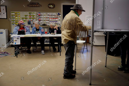 Stock Image of Stuart Wood, from Stockton, Mo., votes at Caplinger Woods RV & Campgrounds, in Stockton, Mo