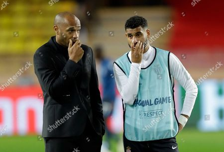 Monaco coach Thierry Henry speaks with Monaco midfielder Youssef Ait-Bennasser before the Champions League Group A soccer match between Monaco and Club Brugge at the Louis II stadium in Monaco