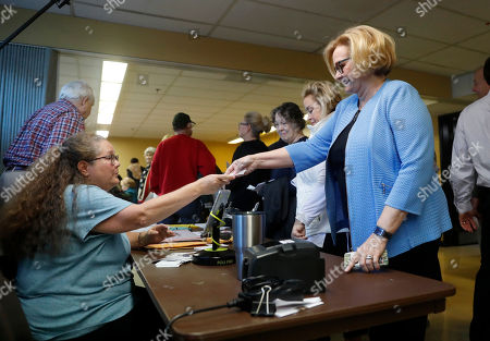 Incumbent Sen. Claire McCaskill, D-Mo., checks in with an election official before casting her ballot, in Kirkwood, Mo