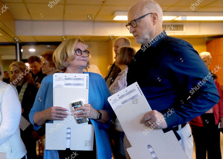 Incumbent Sen. Claire McCaskill, D-Mo., talks with her husband, Joseph Shepard, right, as they stand in line to vote, in Kirkwood, Mo