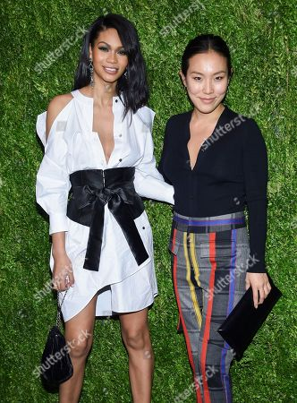 Chanel Iman, Ji Oh. Model Chanel Iman, left, and Ji Oh attend the 15th annual CFDA / Vogue Fashion Fund event at the Brooklyn Navy Yard, in New York