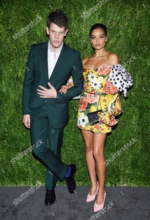 Wes Gordon, Shanina Shaik. Designer Wes Gordon, left, and Shanina Shaik attends the 15th annual CFDA / Vogue Fashion Fund event at the Brooklyn Navy Yard, in New York