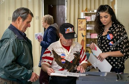 Voter Jerry Thayer (left) has his ballot counted with help from election judges Bruce Dumont and Enijah Russell while voting in the 2018 mid-term general election at First Presbyterian Church in Ferguson, Missouri USA, 06 November 2018. Missouri voters are selecting between incumbent US Senator Claire McCaskill, a Democrat, and Missouri Attorney General Josh Hawley, a Republican, to represent the state in the US Senate.