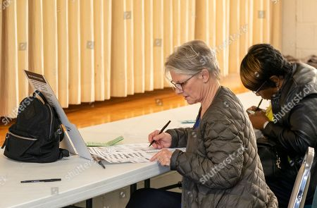 Voters casts their ballots in the 2018 mid-term general election at First Presbyterian Church in Ferguson, Missouri, USA, 06 November 2018. Missouri voters are selecting between incumbent US Senator Claire McCaskill, a Democrat, and Missouri Attorney General Josh Hawley, a Republican, to represent the state in the US Senate.