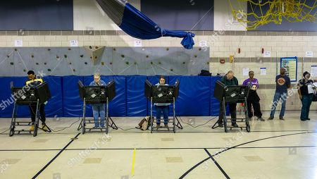 Voters casts their ballots in the 2018 mid-term general election at Johnson-Wabash Elementary School in Ferguson, Missouri USA, 06 November 2018. Missouri voters are selecting between incumbent US Senator Claire McCaskill, a Democrat, and Missouri Attorney General Josh Hawley, a Republican, to represent the state in the US Senate.