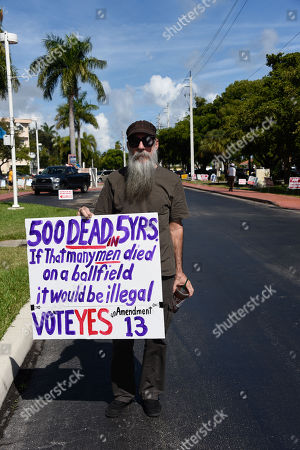 Dan Hughes Protesting Greahound deaths on Amendment 13 in front of the polling staion Voting signs on Midterm election day at polling stations on Tuesday, Nov. 6, 2018 n Hallandale, Fla. Voting signs on Midterm election day at polling stations on Tuesday, Nov. 6, 2018 n Hallandale, Fla.
