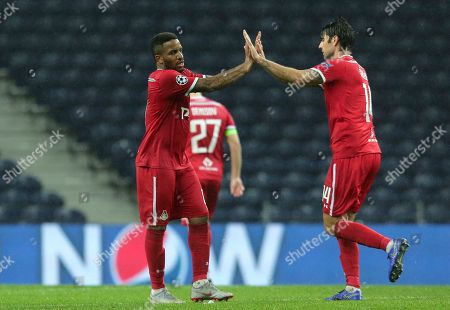 Moscow midfielder Jefferson Farfan celebrates with defender Vedran Corluka, right, after scoring his side's first goal during the Champions League group D soccer match between FC Porto and Lokomotiv Moscow at the Dragao stadium in Porto, Portugal