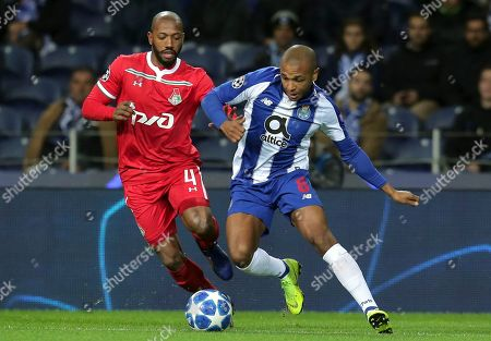 Moscow midfielder Manuel Fernandes vies for the ball with Porto midfielder Yacine Brahimi, right, during the Champions League group D soccer match between FC Porto and Lokomotiv Moscow at the Dragao stadium in Porto, Portugal