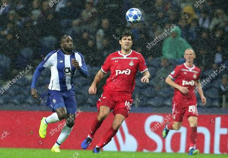 Moscow defender Vedran Corluka vies for the ball with Porto forward Moussa Marega, left, during the Champions League group D soccer match between FC Porto and Lokomotiv Moscow at the Dragao stadium in Porto, Portugal