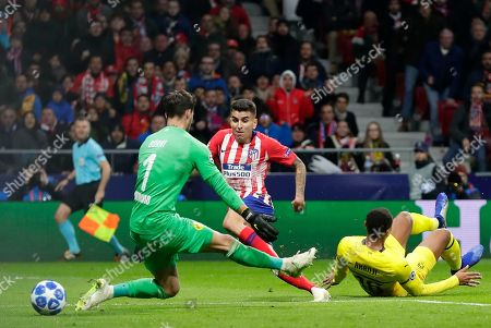 Borussia Dortmund's goalkeeper Roman Burki makes a save during the Group A Champions League soccer match between Atletico Madrid and Borussia Dortmund at the Wanda Metropolitano stadium in Madrid, Spain
