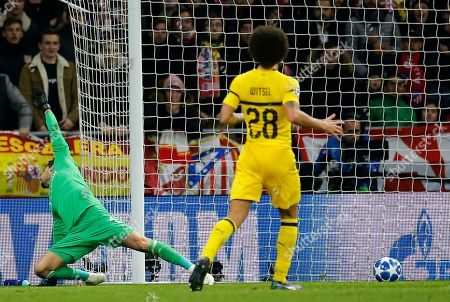 Borussia Dortmund's goalkeeper Roman Burki cannot save the goal from Atletico Antoine Griezmann during the Group A Champions League soccer match between Atletico Madrid and Borussia Dortmund at Wanda Metropolitano stadium in Madrid, Spain