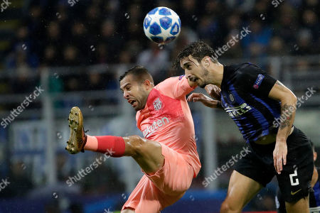 Barcelona defender Jordi Alba, left, and Inter defender Sime Vrsaljko jump for the ball during the Champions League group B soccer match between Inter Milan and Barcelona at the San Siro stadium in Milan, Italy