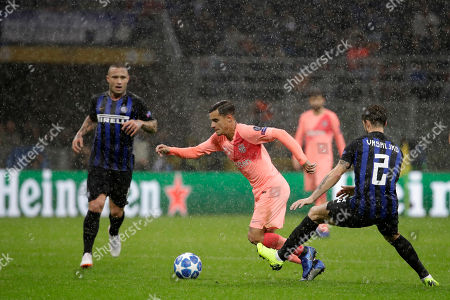 Barcelona forward Philippe Coutinho, center, go for the ball between Inter defender Sime Vrsaljko, right and Inter midfielder Radja Nainggolan during the Champions League group B soccer match between Inter Milan and Barcelona at the San Siro stadium in Milan, Italy