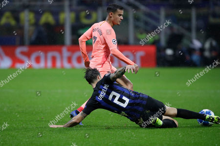 Inter defender Sime Vrsaljko, foreground, fights for the ball against Barcelona forward Philippe Coutinho during the Champions League group B soccer match between Inter Milan and Barcelona at the San Siro stadium in Milan, Italy