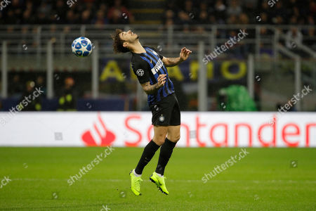 Inter defender Sime Vrsaljko clears the ball during the Champions League group B soccer match between Inter Milan and Barcelona at the San Siro stadium in Milan, Italy