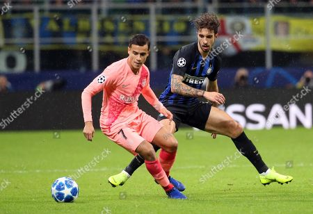 FC Barcelona's Philippe Coutinho (L) and Inter Milan's Sime Vrsaljko in action during the UEFA Champions League group B soccer match between Inter FC and FC Barcelona at the 'Giuseppe Meazza' stadium in Milan, Italy, 06 November  2018.