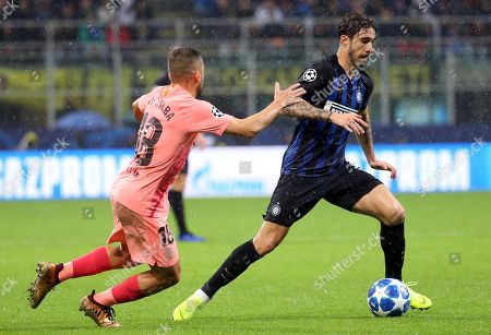 FC Barcelona's Jordi Alba (L) and Inter Milan's Sime Vrsaljko in action during the UEFA Champions League group B soccer match between Inter FC and FC Barcelona at the 'Giuseppe Meazza' stadium in Milan, Italy, 06 November  2018.