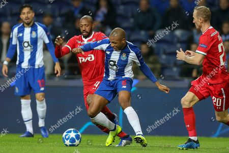FC Porto's Yacine Brahimi (R) in action against Lokomotiv Moscow's Manuel Fernandes (2-L) during the UEFA Champions League group D soccer match between FC Porto and Lokomotiv Moscow at Dragao stadium, Porto, Portugal, 06 November 2018.